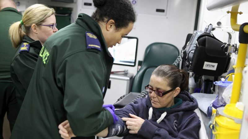 Photo of North West Ambulance Service paramedics attending a patient