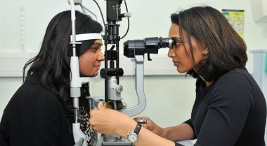 Patient having her eyes checked