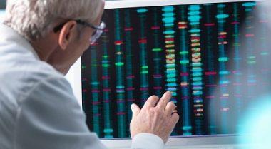 man analysing DNA